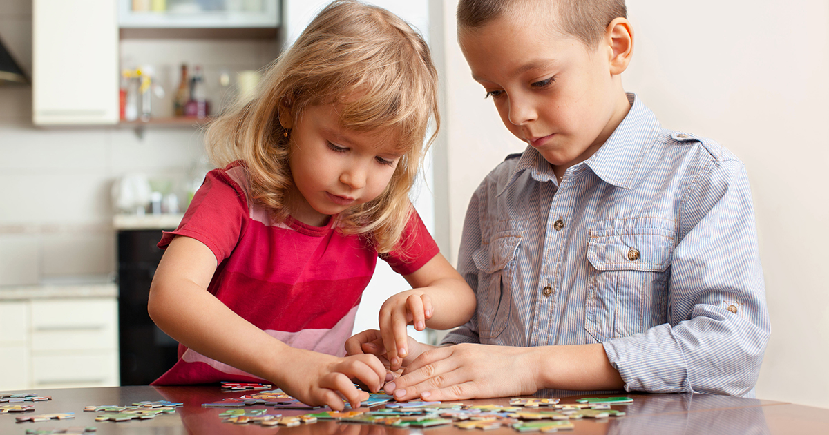 Children Putting together a puzzle