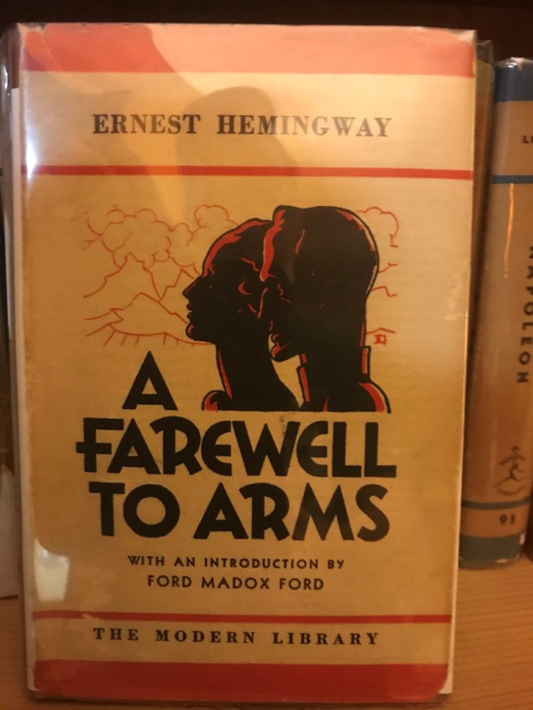 A farewell to Arms cover. Shows two silhouettes printed woth black and highlighted with red ink. Strong typography is below for the title.