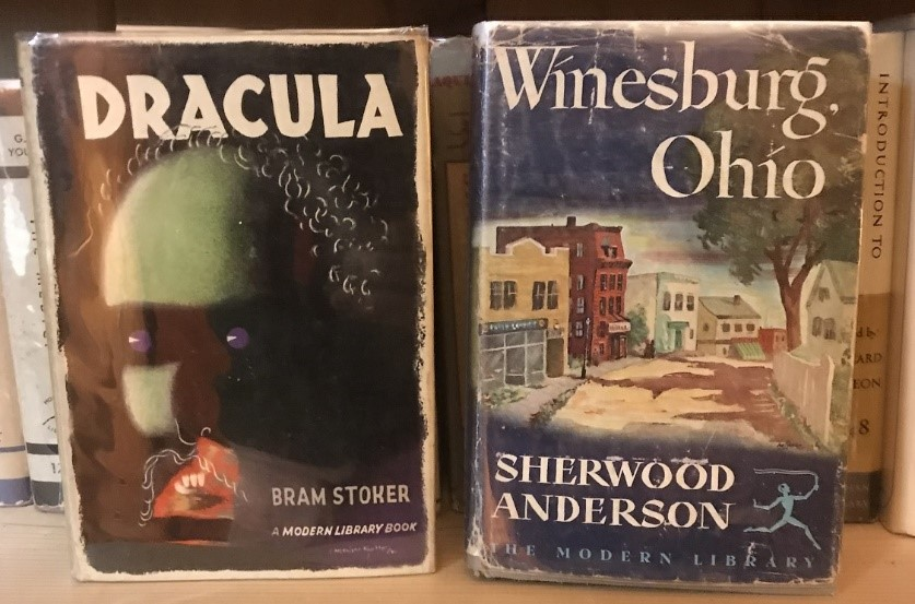 Picture Dracula cover with a green faced monster with abstract curly hair, purple eyes, a red cubistic mouth. Winesburg, Ohio jacket has a old street pictured with a dirt road and old buildings.