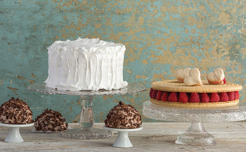 Cakes on pedestals from the fantastical cake book by by Gesine Bullock-Prado; photos by Julia A. Reed and Raymond Prado.